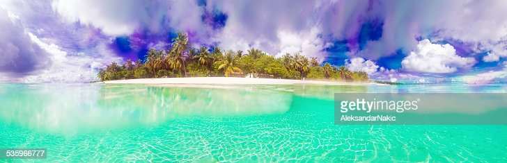 Panoramic photo of a tropical paradise : Stock Photo