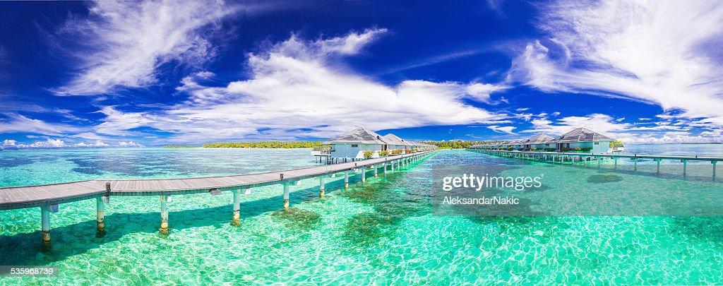 Panoramic photo of Maldivian bungalows : Stock Photo