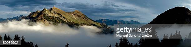 Panoramic Shot Of Alps Against Sky During Foggy Weather
