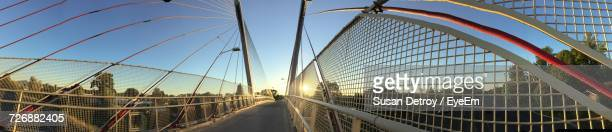 Panoramic Shot Of Empty Bridge Against Blue Sky During Sunset