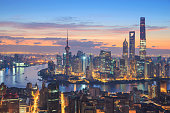 Shanghai Skyline PanoramicPhoto of modern buildings by river at night Pudong new Skyline after year 2014,Shanghai, China