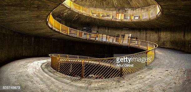 Panoramic spiral ramp of concrete with darkness.