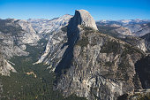 Panoramic summer view of Yosemite valley with Half Dome mountain, Tenaya Canyon, Liberty Cap, Vernal Fall and Nevada Fall, seen from Glacier point overlook, Yosemite National Park, California'n