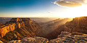 Subject: The sunset view at Cape Royal of the North Rim of the Grand Canyon National Park. Photographed in panoramic horizontal format at dusk. The Grand Canyon National Park, one of the many a popula
