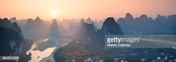Panoramic sunset over Li river and karst mountains, China