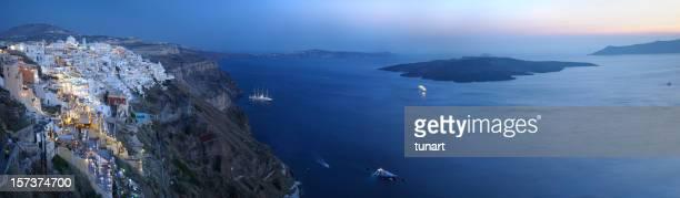 Panoramic sunset view of Santorini and Aegean sea, Greece