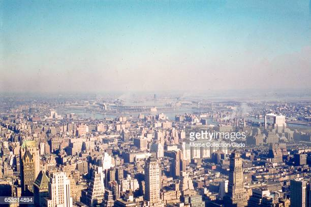 Panoramic view facing northeast of the Lenox Hill neighborhood of upper Manhattan the East River northwest Queens and the southern tip of the Bronx...