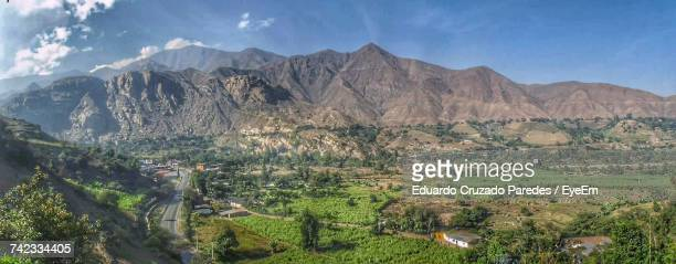 Panoramic View Of Agricultural Field And Mountains Against Sky