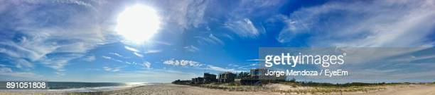 Panoramic View Of Beach Against Cloudy Sky