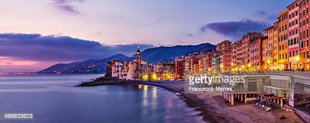 Panoramic view of beach and hotels at sunset, Camogli, Liguria, Italy