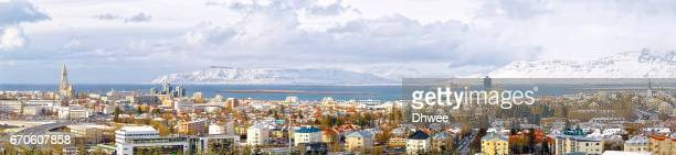 Panoramic View Of Beautiful Reykjavik City With Snowcapped Mountains Akrafjall And Esja.