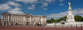 A panoramic view of Buckingham Palace devoid of the usual crowds Blue sky with a few clouds