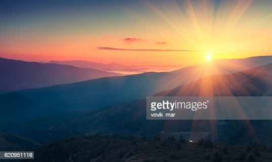 Panoramic view of  colorful sunrise in mountains. : Stock Photo