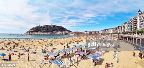 Panoramic View Of Crowded La Concha Beach In Summer, San sebastian or Donostia City Spain