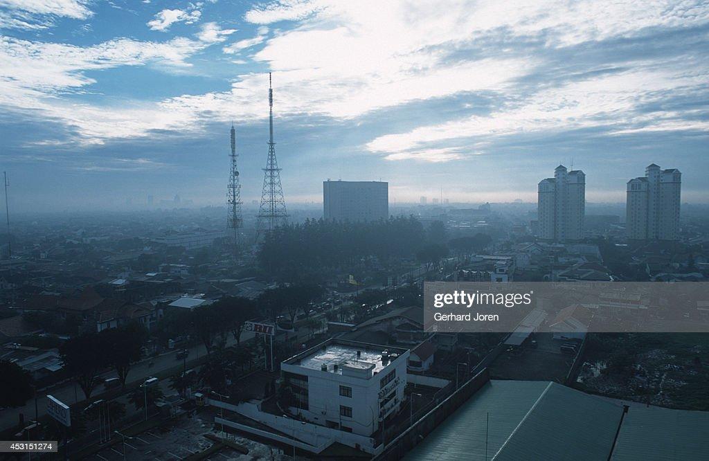 A panoramic view of downtown Surabaya which lies beneath a veil of haze