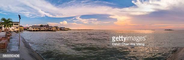 Panoramic view of dramatic sky during sunset at seaside in Jalan Minyak Beku - Batu Pahat, Johor - Malaysia