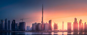 Mystical panoramic view of Dubai Business bay with at violet spectacular sunset, UAE
