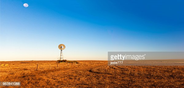 Panoramic view of early morning landscape with a windmill. : Stock Photo