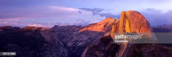 Panoramic view of Glacier Point over a purple sky at dusk