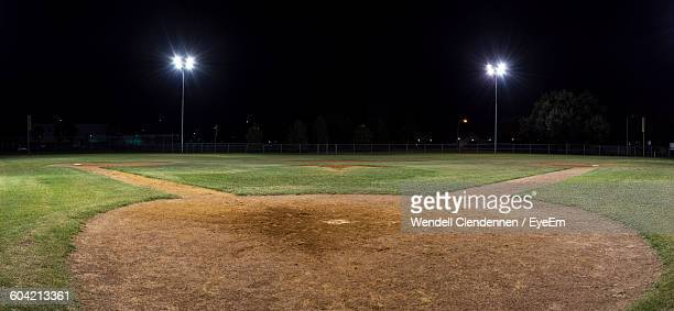Panoramic View Of Illuminated Baseball Field Against Sky At Night