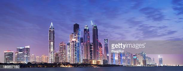 Panoramic View of Illuminated Dubai Marina Skyline at Night UAE