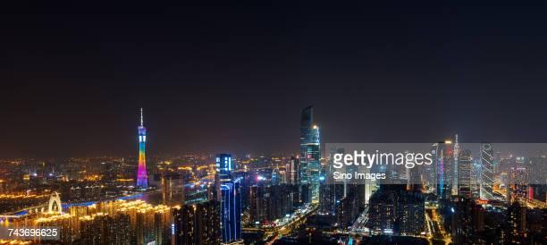 Panoramic view of illuminated modern skyscrapers at night, Guangzhou, Guangdong, China