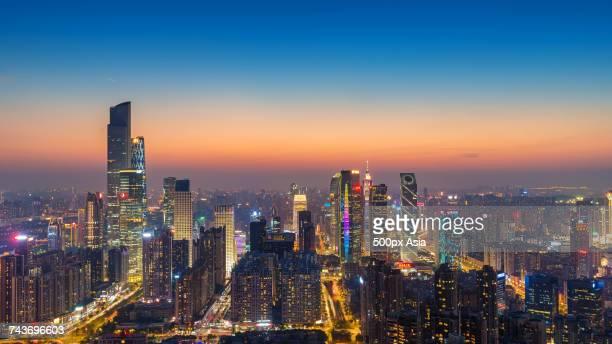 Panoramic view of illuminated modern skyscrapers in financial district at sunset, Zhujiang New Town, Guangzhou, Guangdong, China