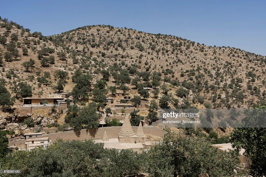 Panoramic view of Lalish, sacred Yazidi village : Stock Photo