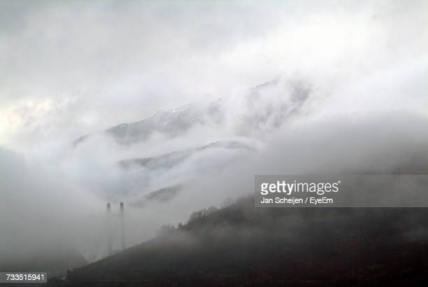 Panoramic View Of Landscape Against Sky During Foggy Weather