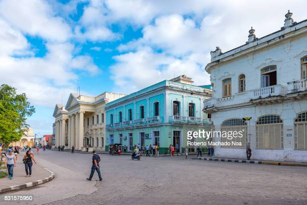 Panoramic view of Leoncio Vidal plaza or town square Two story colonial buildings across a city road The area is a Cuban National Monument