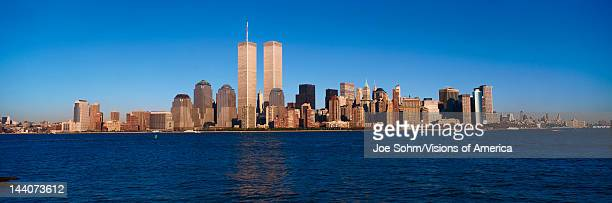 Panoramic view of lower Manhattan and Hudson River New York City skyline NY with World Trade Towers at sunset
