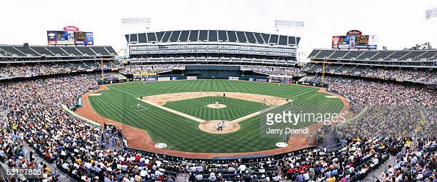 Panoramic view of McAfee Coliseum from behind home plate lower level during a game between the Seattle Marines and the Oakland Athletics on April 30...