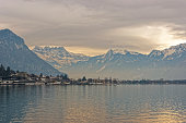 Panoramic View of Montreux and Lake Geneva at sunset in winter. Montreux is a city in the canton of Vaud in Switzerland. It is located on Lake Geneva at the foot of the Alps.
