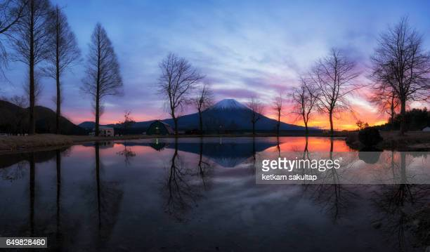 Panoramic view of mount fuji and reflection at dusk.