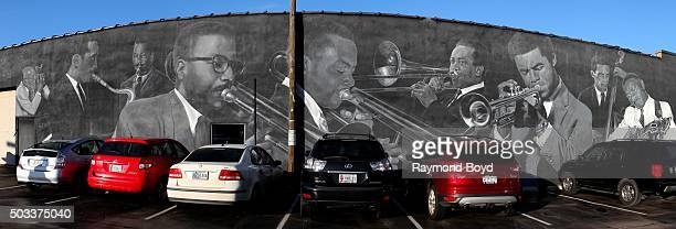 Panoramic view of Pamela Bliss' 'Jazz Masters Of Indiana Avenue' mural featuring David Young Jimmy Coe David Baker JJ Jphnson Slide Hampton Freddie...