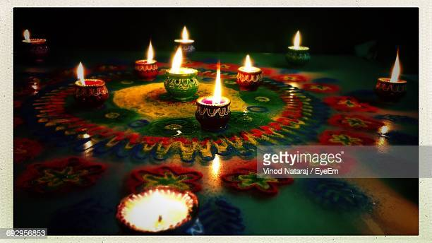 Panoramic View Of Rangoli With Lit Diyas