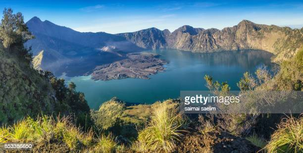 Panoramic view of Rinjani volcano mountain and Anak lake, Senaru crater rim, Lombok island, Indonesia