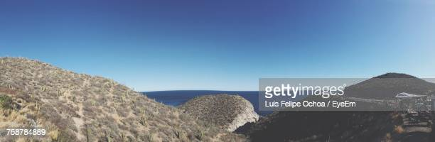 Panoramic View Of Sea Against Clear Blue Sky