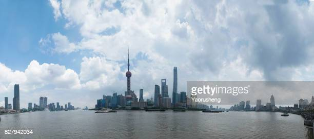 panoramic view of shanghai skyline with huangpu river and blue sky