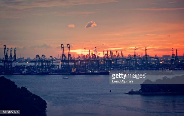 Panoramic view of Singapore container port at sunset, Singapore - August 22, 2017