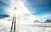 Panoramic view of ski resort glacier and chair lift in french alps - Winter vacation and travel concept - Winter high season opening with people having fun on mountain - Focus on sport equipment