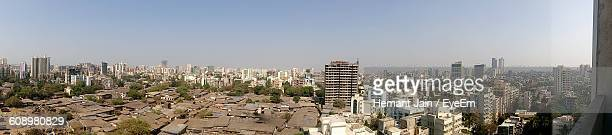 Panoramic View Of Slum And City Against Clear Sky