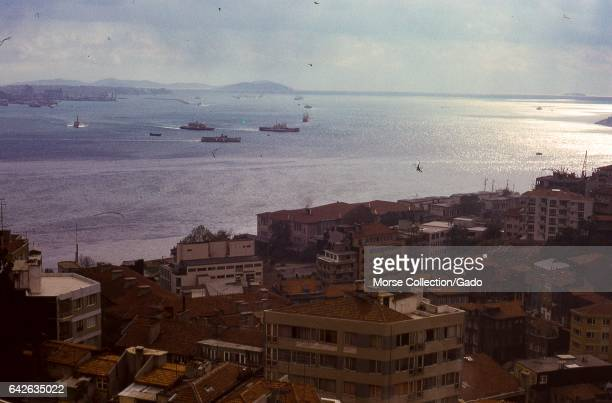 Panoramic view of the Bosphorus strait facing south toward the Sea of Marmara in Istanbul Turkey November 1973 Large boats and small vessels crowd...
