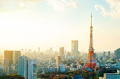 Business concept for real estate and corporate construction - Tokyo tower, landmark of Japan, and panoramic modern city bird eye view with dramatic sunrise and morning sky