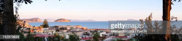 Panoramic View Of Town By Sea Against Clear Sky