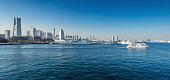 Panoramic view of a port city. Yokohama Minato Mirai 21 Area in Yokohama, Japan viewed from Osanbashi Pier.