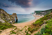 panoramic view over beach with Durdle Door landmark in Dorset Jurassic Coast, UK
