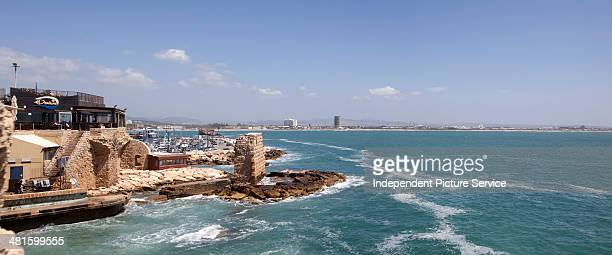 Panoramic view showing a seaside restaurant harbor and Bay of Haifa in Acre Israel
