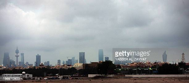 A panoramic view shows Kuwait city's skyline on a rainy day on November 26 2012 The tiny Gulf emirate is getting ready for the December 1...