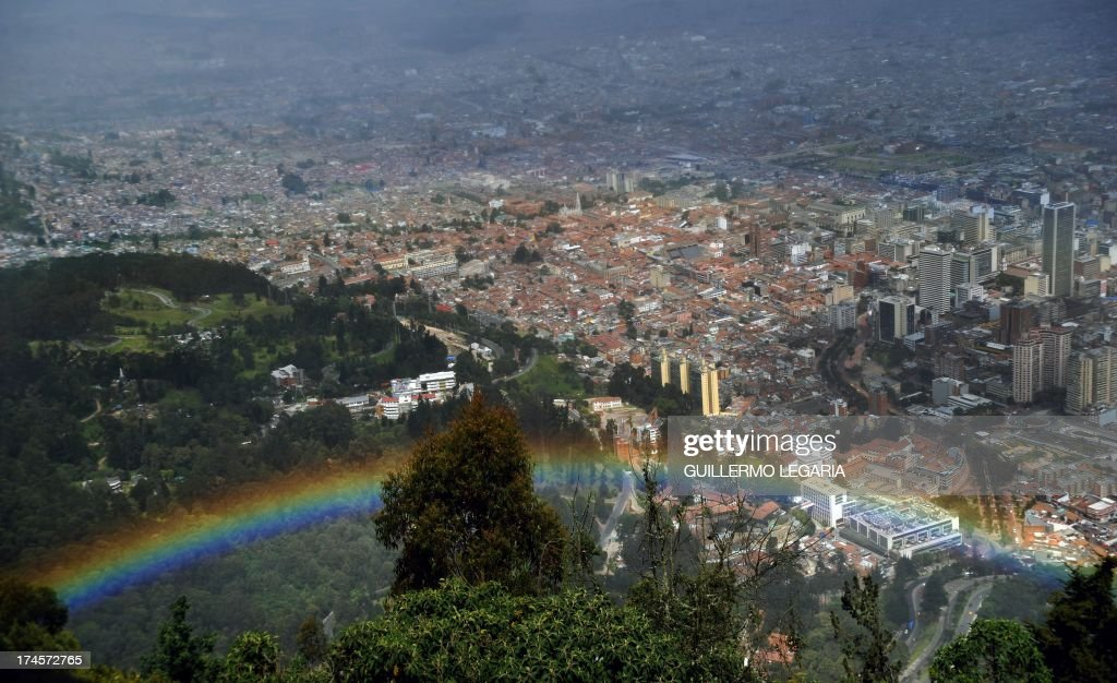 Panoramic view taken from the Cerro de Monserrate of a rainbow with city of Bogota in the background, in Colombia, on July 27, 2013